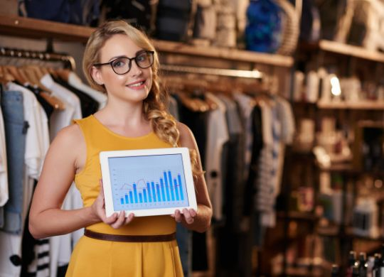 retail industry rf keeper RF Keeper and DENSO WAVE- Digitally transforms the Brick and Mortar stores. young caucasian woman standing boutique shop showing tablet with business graph 1098 20657 scalia blog default