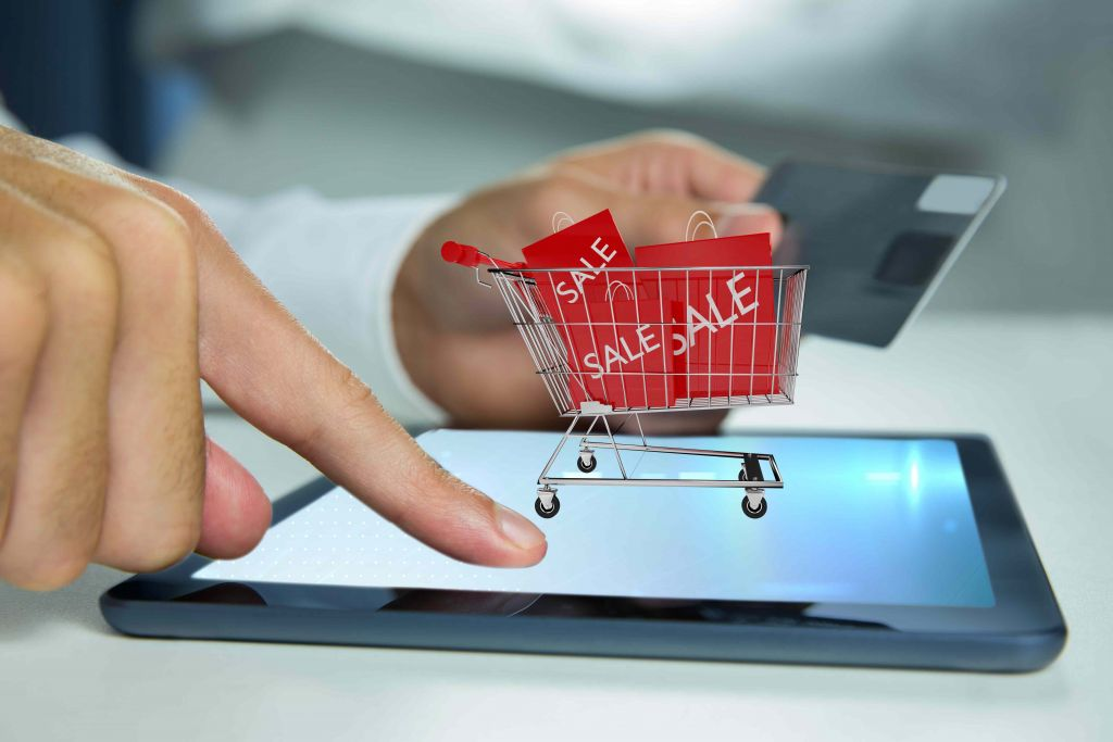 ecommerce cashless payment  Contactless Payment- Retailers taking next step to stay relevant man playing tablet with shopping cart 1024x683