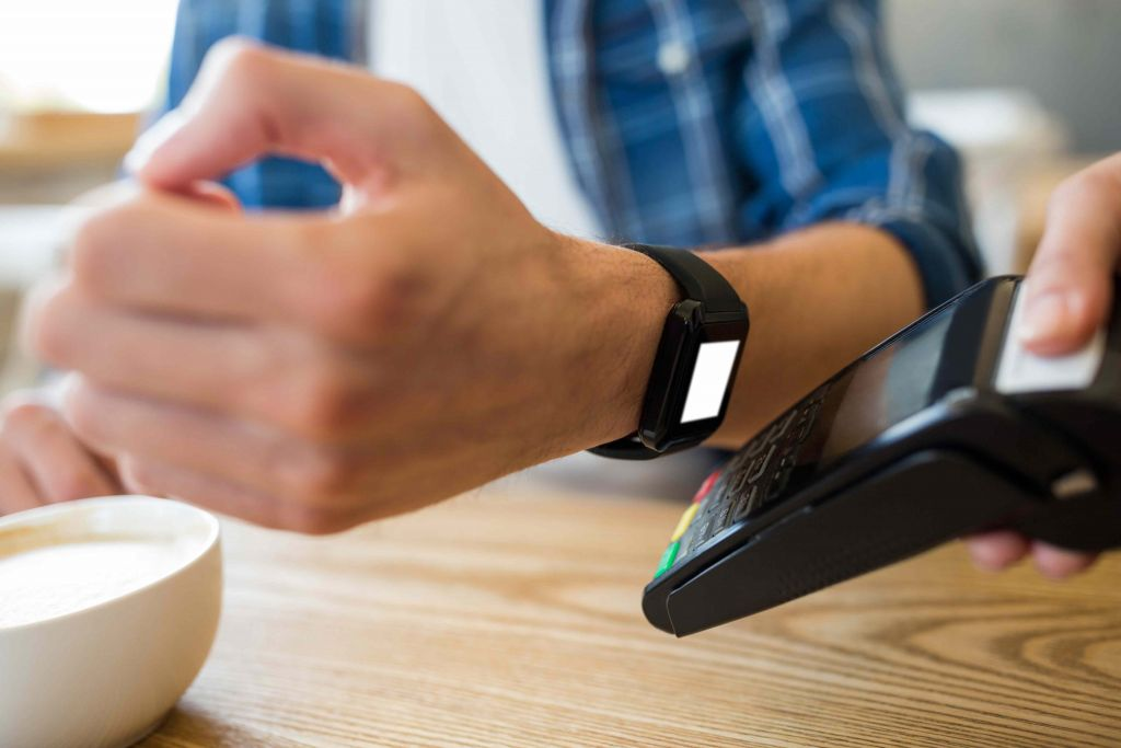 retailpro  Contactless Payment- Retailers taking next step to stay relevant man using smart watch express pay 2 1024x683