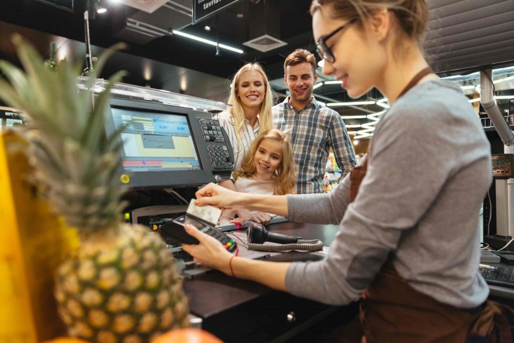 Point of sale systems pos system Quick Guide to POS System- Here's What Really Matters in Point Of Sale Systems smiling family paying with credit card 1024x683
