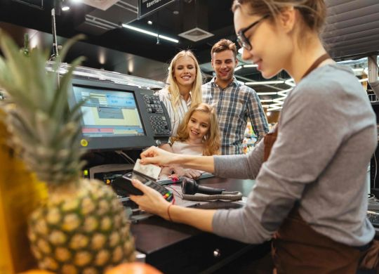 pos system pos system Quick Guide to POS System- Here's What Really Matters in Point Of Sale Systems smiling family paying with credit card scalia blog default